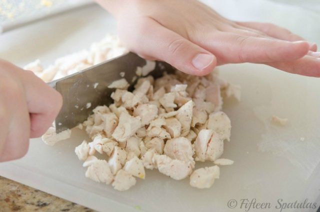 chopping chicken breast for buffalo chicken dip