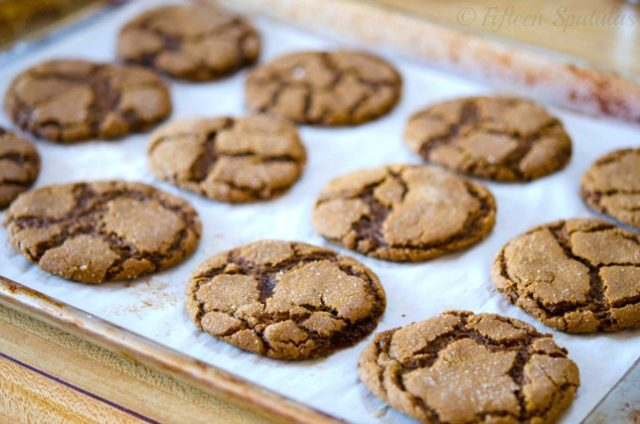 ginger molasses cookies baked on parchment for holidays