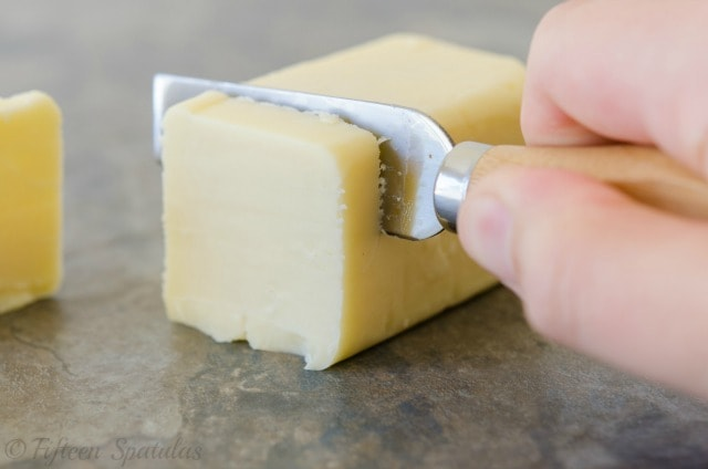 Slicing white cheddar to pair with wine