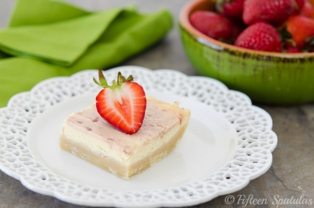 a square of strawberry swirled cheesecake shortbread crust bars