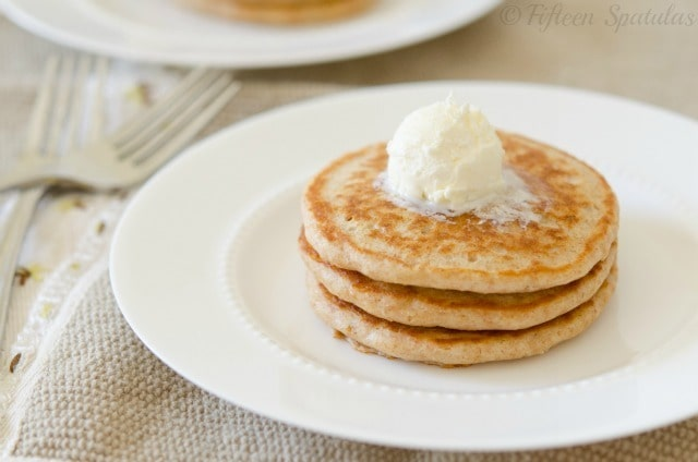 a stack of whole wheat flour pancakes with butter
