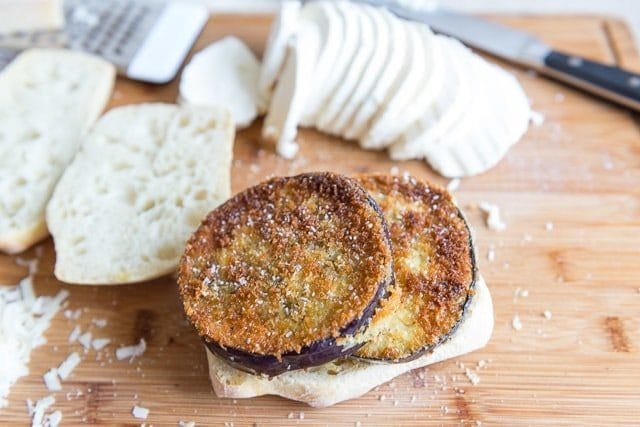 Eggplant Parmesan Sandwiches are a great recipe for an easy and delicious lunch. Crispy fried eggplant sandwiched with mozzarella, basil, and marinara sauce on a ciabatta roll