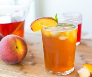 This Sparkling Peach Iced Tea has freshly brewed rooibos tea, a homemade peach simple syrup, and a splash of seltzer for a refreshing drink!