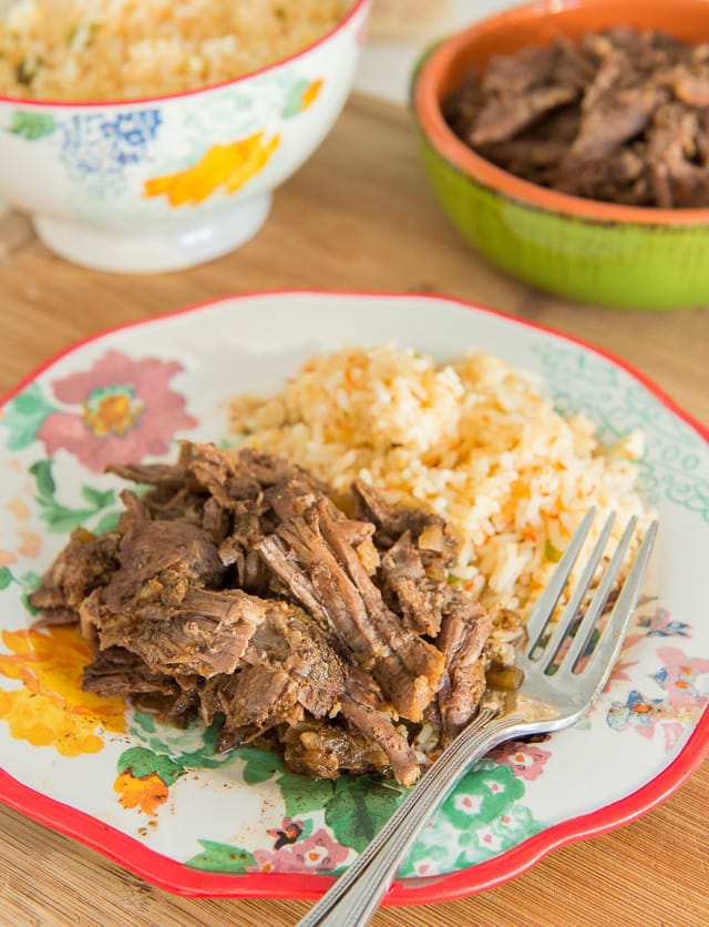 This Slow Cooker Shredded Mexican Beef is SO EASY!! Throw a handful of ingredients into the crockpot, let cook for 4 hours, then shred it up!