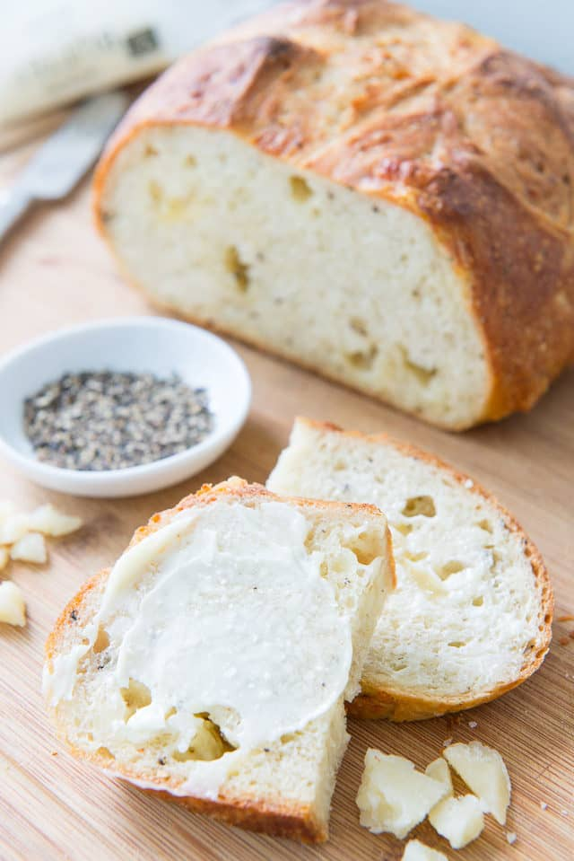 No kneading is required for this easy, artisanal-quality Asiago Black Pepper Bread. Simply mix together six ingredients before bed, shape the dough into a boule in the morning, then bake it after a brief res
