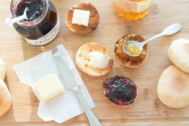 English Muffin Recipe - Served Toasted on Wooden Board with butter and jams