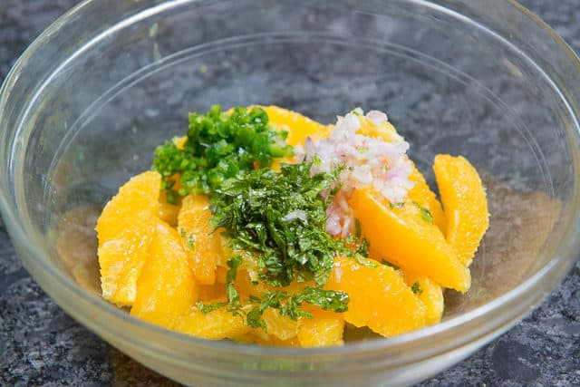 Orange Segments, Jalapeno, Herbs, and Shallot in a Glass Bowl