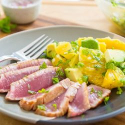 Seared Ahi Tuna Sliced Thinly On a Plate with Orange Salad