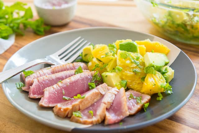 Seared Tuna Recipe - Sliced and Presented on a Multicolor Plate with Orange Salad