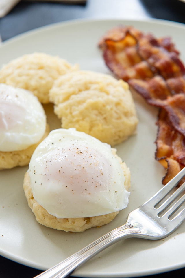 How to Make Poached Eggs - Shown on Biscuit with Pepper and Bacon
