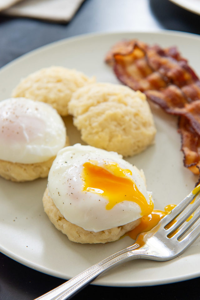 How to Poach an Egg - End Result on a Plate with Biscuits and Bacon
