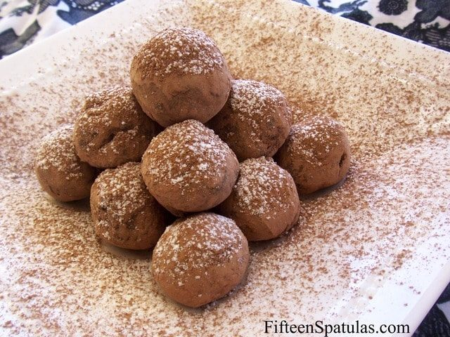 Chocolate Truffles - Homemade and Sprinkled with Extra Cocoa Stacked in a Pile