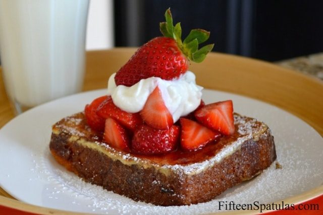 Brioche French Toast - Dusted with Powdered Sugar, Topped with Strawberries and Whipped Cream