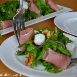 Arugula Salad - With Prosciutto, Goat Cheese, and Walnuts on White Plate