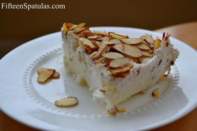 Tortoni - Sliced and Topped with Sliced Almonds on White Plate