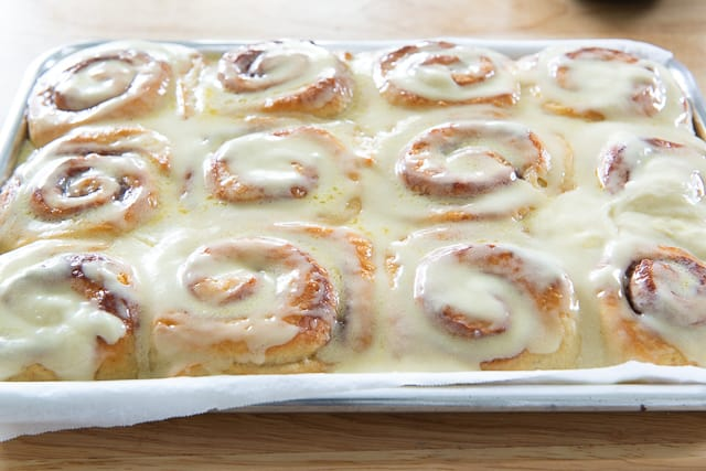 Best Cinnamon Roll Recipe - With Orange Butter Icing on Top that melts into all the crevices!