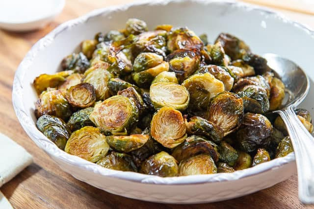 Oven Roasted Brussel Sprouts in a White Bowl