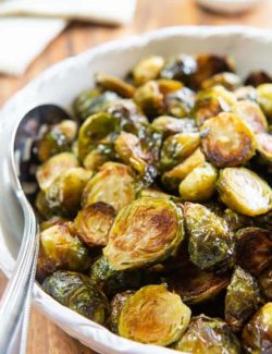 Roasted Brussel Sprouts - In a White Bowl with Spoon
