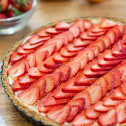 Strawberry Tart on a Wooden Board in the Metal Shell