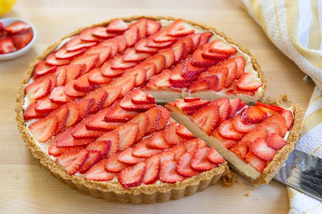 Strawberry Tart Recipe - With Slice Being Taken from the Whole Tart