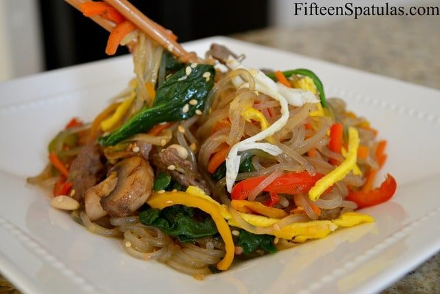 Jap Chae - Korean Glass Noodles with Spinach, Mushroom, Egg, and More in White Dish