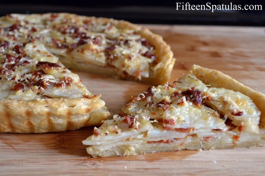 Potato Tart Slice with Full Tart in Background