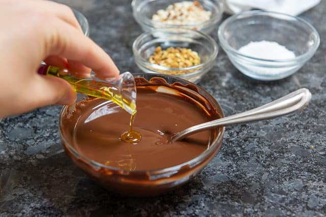 Pouring Oil Into Melted Chocolate to Loosen for Dipping
