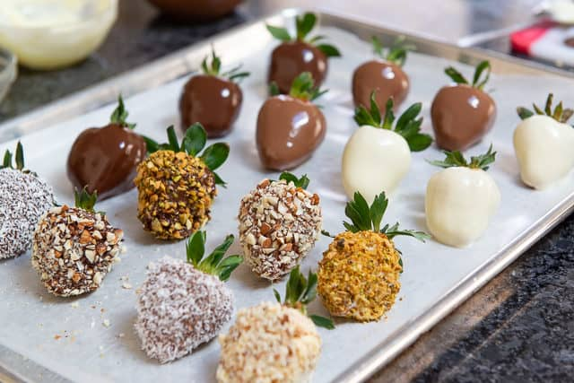 White Chocolate Covered Strawberries, Milk Chocolate Strawberries, on Wax Paper with Nuts and coconut