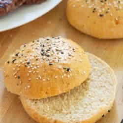 Homemade Whole Wheat Hamburger Buns Sliced on a Board
