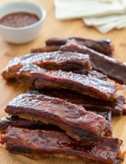 Spare Ribs - Made in the Oven with BBQ Sauce and Plated on Wooden Board