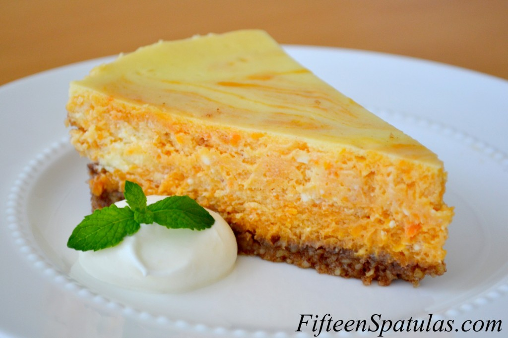 Sweet Potato Cheesecake - Sliced and Served on White Plate with Whipped Cream and Mint Sprig