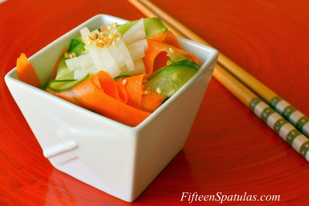 Cucumber Carrot Salad - With Ribbons of Each in White Takeout Dish and Chopsticks in Background