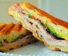Homemade Cuban Sandwich - Sliced in Half to show Rubbed Pork Tenderloin and Filling