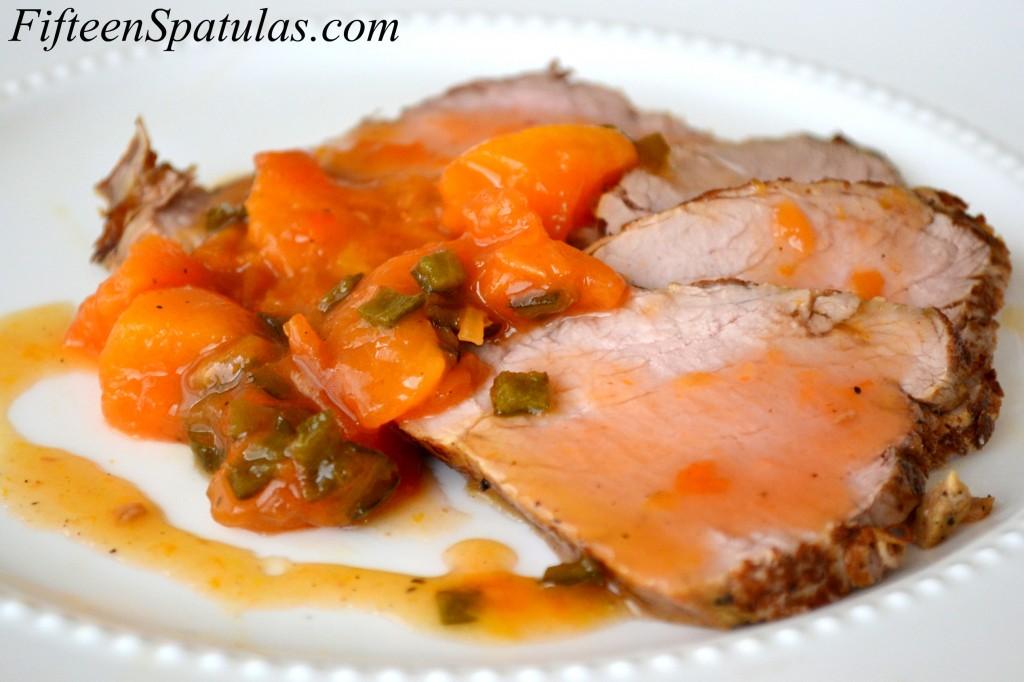 Slices of Pork Tenderloin with Peach Serrano Sauce on Top