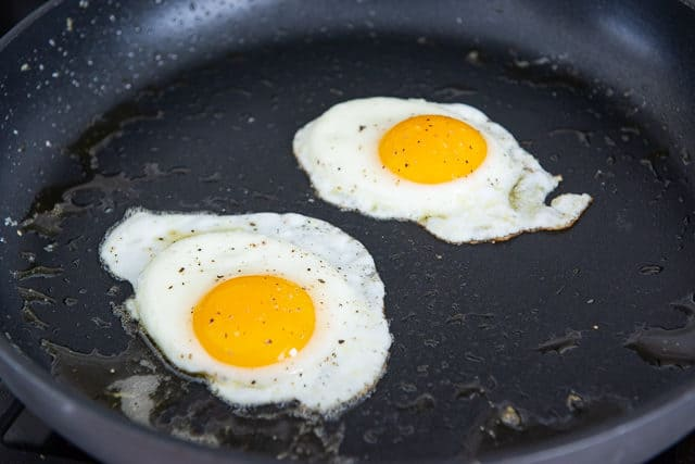 Two Fried Eggs in a Nonstick Skillet (It\'s the difference between Croque Madame vs Croque Monsieur)