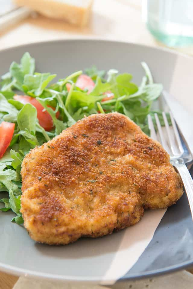 Parmesan Breaded Pork Chop on a Plate with Side Salad