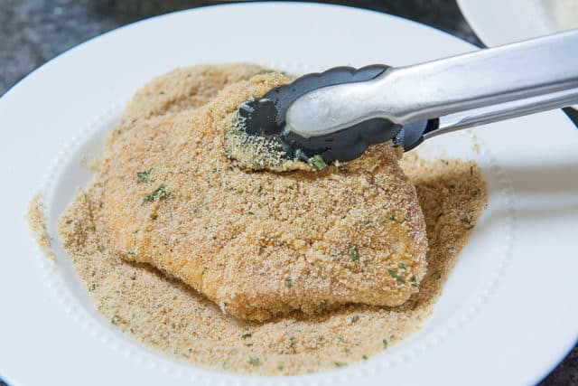 Coating the Pork Chop in Italian Seasoned Bread Crumbs
