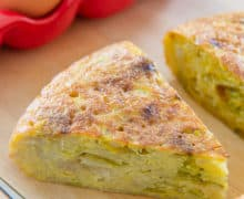 Slice of Spanish Tortilla with Eggs in Background
