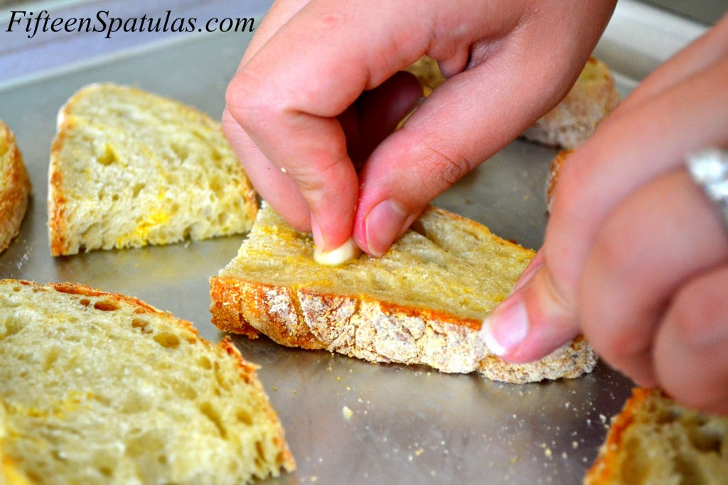 Rubbing Garlic on Toasted Bread to Impart Flavor