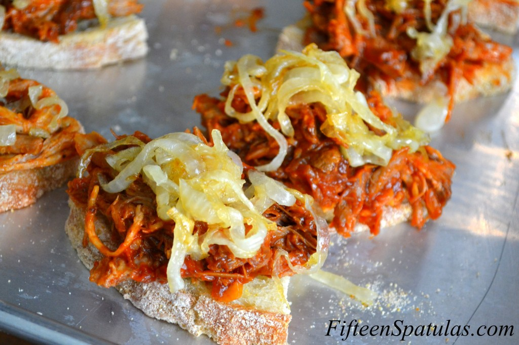 Caramelized Onions Piled On Shredded BBQ Sauce Pork on Slices of Bread