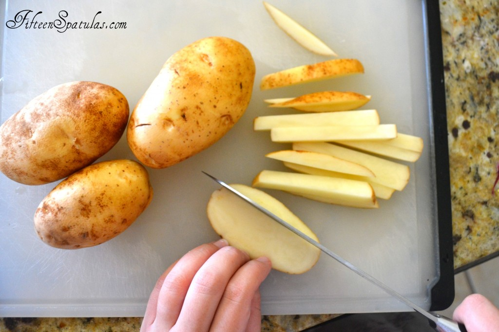 Slicing Russet Potatoes into Fry Shape Before Deep Frying