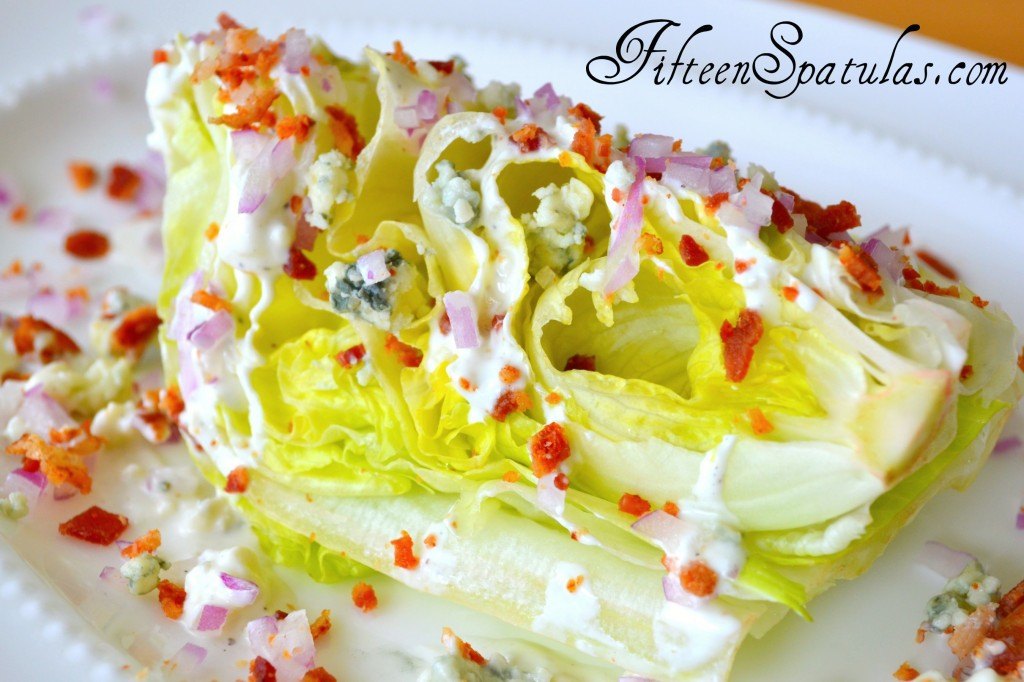 Iceberg Wedge - On White Plate with Red Onion, Crumbled Bacon, and Gorgonzola on Top