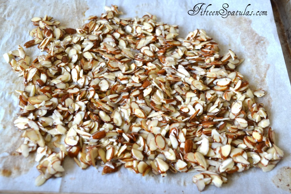 Candied Sliced Almond Brittle on Parchment Ready to Be Baked