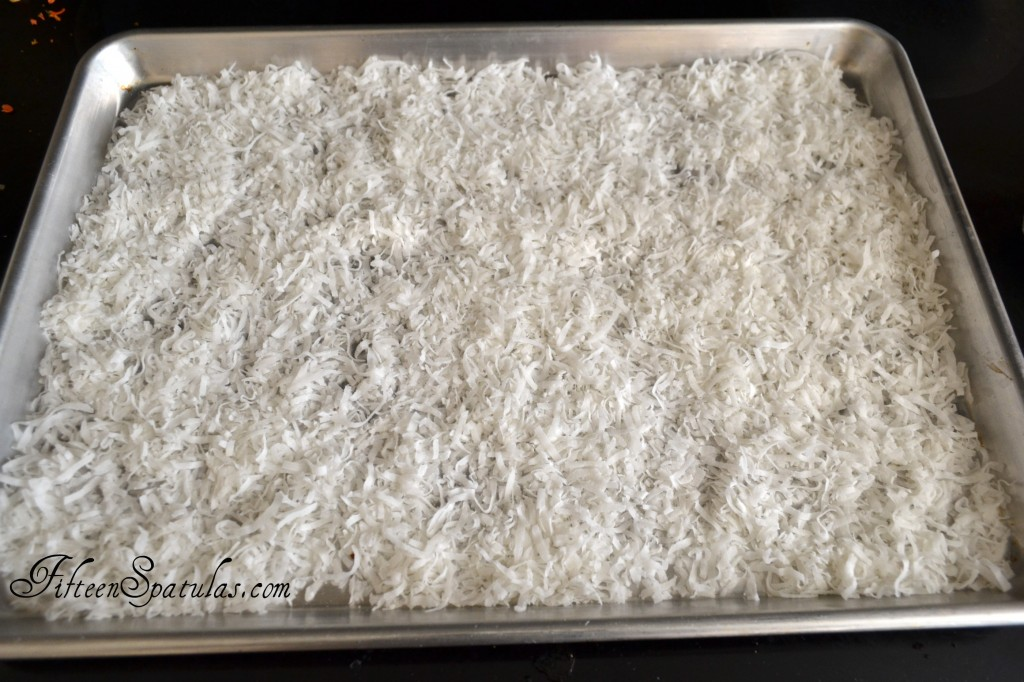 Shredded Sweetened Coconut Spread in Thin Layer on Sheet Pan