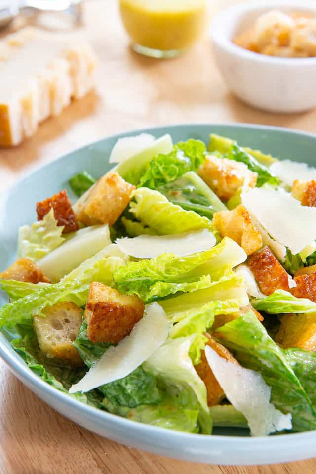 Caesar Salad - In a Blue Bowl with Croutons and Parmesan Shavings