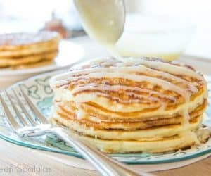 Cinnamon Roll Pancakes are a fun recipe to make for a special breakfast or brunch! Fluffy pancakes with a cinnamon bun filling swirl and drizzled with cream cheese frosting!