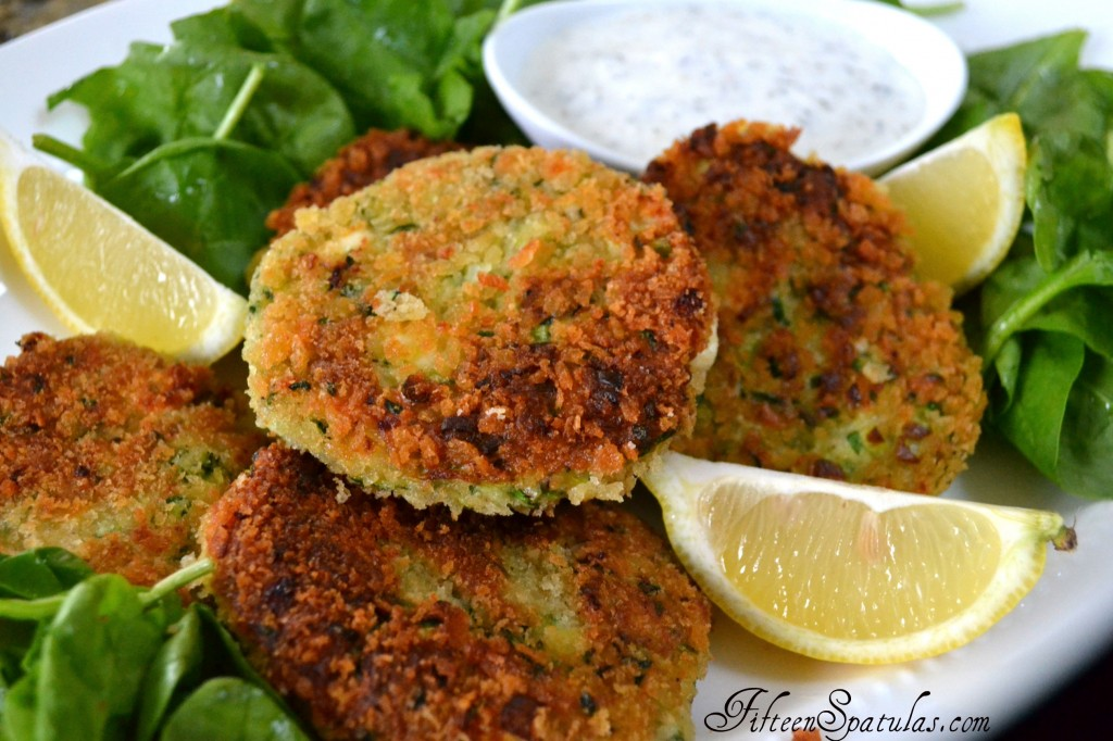 Zucchini Cakes on Platter with Dipping Sauce and Lemon Wedges