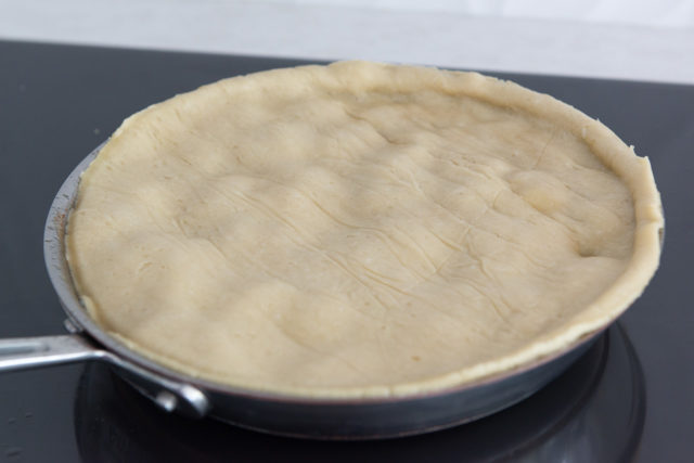 Skillet with Uncooked Pie Crust Circle On Top