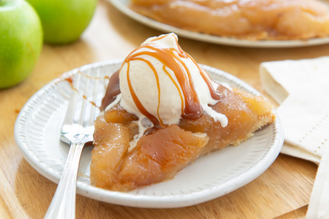 Tarte Tatin Recipe - Shown Sliced and Plated with Ice Cream and Caramel