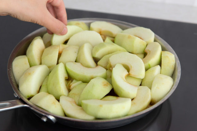 Adding Slices of Granny Smith Apple to the Skillet